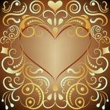 Ornamento dourado dado forma coração Foto de Stock