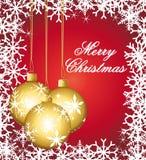 Ornamento dourados em um cartão festivo vermelho. Imagens de Stock
