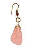 Ornamento fêmea um brinco com quartzo cor-de-rosa foto de stock
