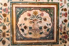 Ornamento floral en la pared en Amber Fort Fotografía de archivo