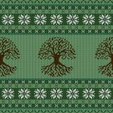 Ornamento inconsútil de lana hecho punto con el árbol céltico de la vida y de los copos de nieve ilustración del vector