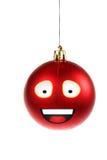 Ornamento redondo vermelho animado ou ilustrado de um smiley para Cristo Fotografia de Stock Royalty Free