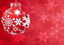 Ornamento rosso di natale con il reticolo dei fiocchi di neve Fotografia Stock