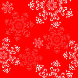 Ornamento sem emenda com flocos de neve decorativos em um vermelho festivo Foto de Stock Royalty Free