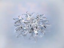 Ornamento sotto forma d'un fiocco di neve su un BAC bianco Fotografia Stock