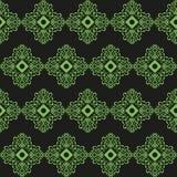 Ornamento verde en un backgroun negro Imagen de archivo