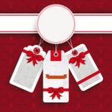 Ornamentos blancos de las etiquetas engomadas del precio de la Navidad del emblema Imagenes de archivo
