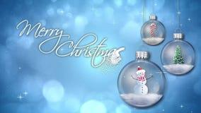 Ornamentos de balanceo en lazo azul del texto de la Feliz Navidad libre illustration