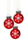 Ornamentos de la Navidad de la ejecución con los copos de nieve Foto de archivo libre de regalías