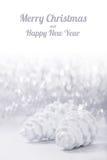 Ornamentos de la Navidad de plata y blanca en fondo del bokeh del brillo con el espacio para el texto Navidad y Feliz Año Nuevo Fotografía de archivo