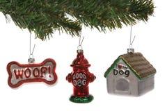 Ornamentos de la Navidad del perro fotos de archivo