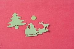 Ornamentos de la Navidad en un fondo rojo Fotos de archivo libres de regalías