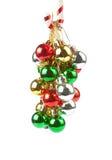 Ornamentos de la Navidad que cuelgan en el bastón de caramelo Imagen de archivo libre de regalías