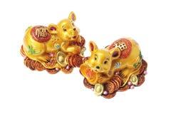 Ornamentos de oro chinos de la rata Fotografía de archivo