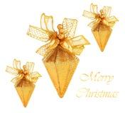 Ornamentos de oro del árbol de navidad Imágenes de archivo libres de regalías