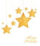 Ornamentos de oro del árbol de navidad de las estrellas Imágenes de archivo libres de regalías