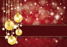 Ornamentos de oro del rojo del brillo de Bokeh de las estrellas de las chucherías Foto de archivo libre de regalías