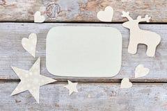Ornamentos de papel de la Navidad y papel vacío Imagen de archivo libre de regalías