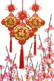 Ornamentos del Año Nuevo y flor chinos del ciruelo Fotos de archivo