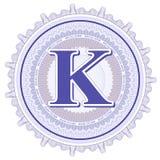 Ornamentos geométricos del vector Rosetones del guilloquis con la letra K Foto de archivo libre de regalías