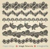 Ornamentos negros de las flores Fotografía de archivo libre de regalías