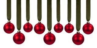 Ornamentos rojos de la Navidad Fotos de archivo