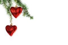 Ornamentos rojos de la Navidad del corazón Fotos de archivo libres de regalías