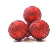 Ornamentos rojos del día de fiesta Fotos de archivo libres de regalías