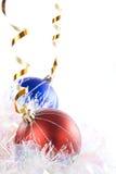Ornamentos rojos y azules Imagenes de archivo