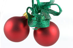 Ornaments alpha. Red Christmas ornaments with a green metallic ribbon royalty free stock images