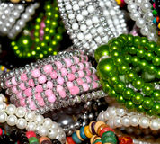Female ornaments jewelry stock photos. Beautiful female bracelets ornaments background photograph royalty free stock photos