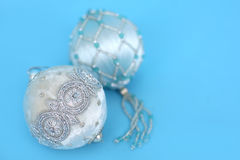 Ornaments on blue. Ornate christmas ornaments on a blue background Royalty Free Stock Image