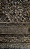 Ornaments of the bronze-plate door of a historic mosque in Cairo, Egypt royalty free stock image