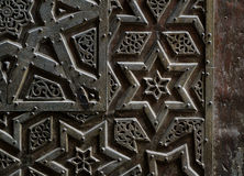 Ornaments of the bronze-plate door of an old mosque Royalty Free Stock Photo