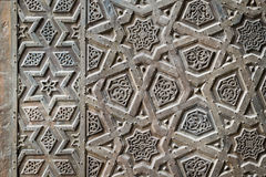 Ornaments of the bronze-plate door of an old mosque Stock Photos