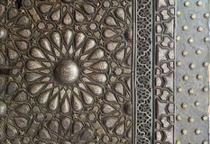 Ornaments of the bronze-plate ornate door, Manial Palace of Prince Mohammed Ali Tewfik, Cairo, Egypt royalty free stock images