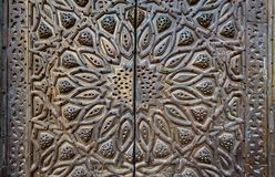 Ornaments of  bronze-plate ornate door Royalty Free Stock Photography