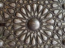 Ornaments of the bronze-plate ornate door, Palace of Prince Mohammed Ali Tewfik, Cairo, Egypt. Ornaments of the bronze-plate ornate door of the residence hall of Stock Images