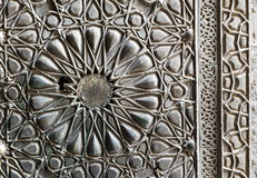 Ornaments of the bronze-plate ornate door of Sultan Barkouk Mosque. An ancient historic mosque in Old Cairo, Egypt Royalty Free Stock Photos