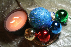 Ornaments and Candle Light. A beautiful composition of light and Christmas items royalty free stock photo