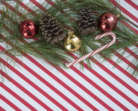 Ornaments  on candy cane stripes Royalty Free Stock Images