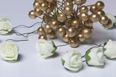 Ornaments for celebrations. A bouquet of artificial flowers.  Roses beige on a white background. Stock Photography