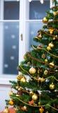 Ornaments on Christmas tree Stock Photo