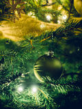 Ornaments on Christmas tree Stock Images