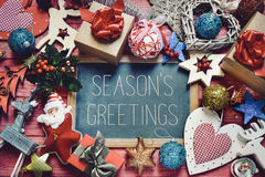 Ornaments and gifts and text seasons greetings Stock Photos