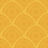 Ornaments in gold colors. Seamless wallpaper pattern. Royalty Free Stock Image