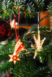 Ornaments hang from a Christmas Tree. During  the holidays Stock Photos