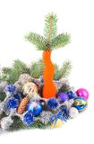 Ornaments by holiday. Orange vase with green branch of coniferous tree and New Year's ornaments spheres on white background Royalty Free Stock Photos