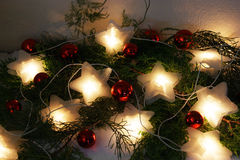 Ornaments on holiday. Burning a garland and Christmas decorations Stock Photo