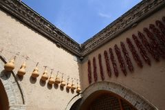 Ornaments of ladle and pepper hang in the sunken courtyard Stock Photo